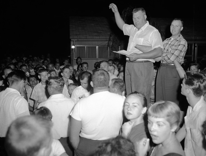 Residents of Levittown, Penn., are shown during a rally to protest plans by William Myers, a black man, to move into a home in the all-white community of 60,000 persons, Aug. 17, 1957.  (Bill Ingraham / AP)