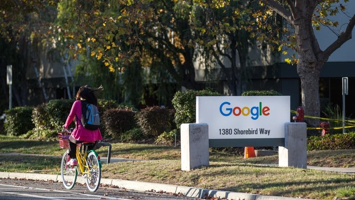 A person rides a bike at Google's Mountain View Campus.