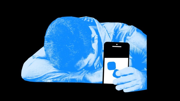 Illustration of a sad person with their smartphone.