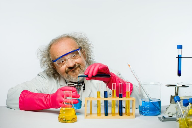 This one has it all. Einstein hair, mad scientist, white lab coat, beakers of thoroughly unscientific fluid. Never use it, unless it's to mock these clichés. Shutterstock