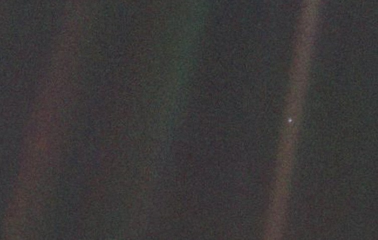 This pale blue dot, less than a pixel in size, is Voyager 1's view of Earth.