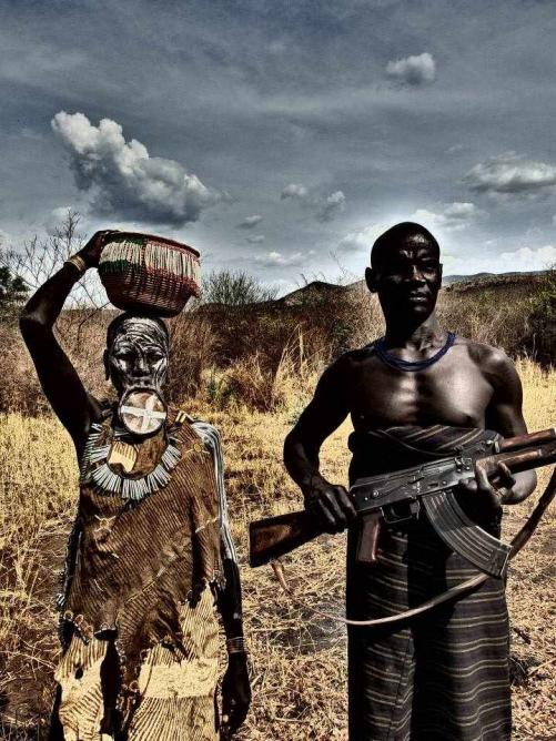 Mursi couple with AK 47 and lip plate