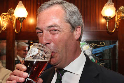 Farage returns to work posing with a pint and grinning like a twat