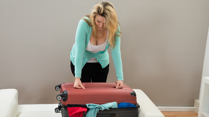Woman with 37 tops packed for overnight trip adds a 38th