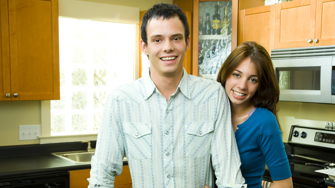 Couple with sign saying 'This kitchen is for dancing' mainly use it for drinking