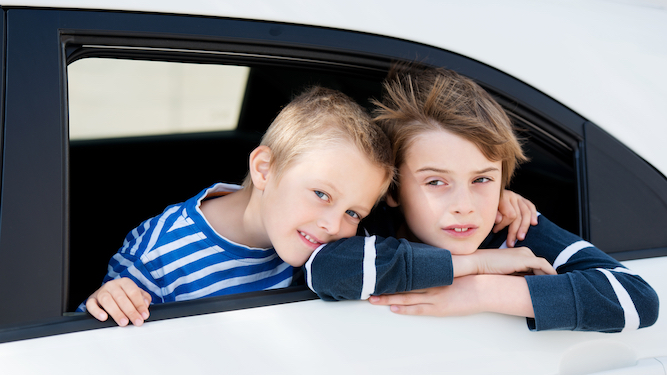 Kids wait in car with pop and crisps while parents get pissed in mate's garden