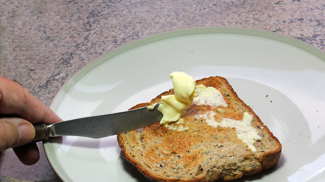 Tub of butter approaching 50 per cent toast crumbs