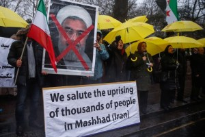 Opponents of Iranian President Hassan Rouhani hold a protest outside the Iranian embassy in west London, December 31, 2017. Credit: Reuters/Eddie Keogh