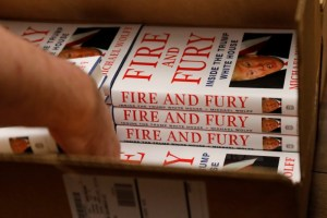 """An employee of Book Culture book store unloads copies of """"Fire and Fury: Inside the Trump White House"""" by author Michael Wolff inside the store in New York, US January 5, 2018. Credit:Reuters/Shannon Stapleton"""