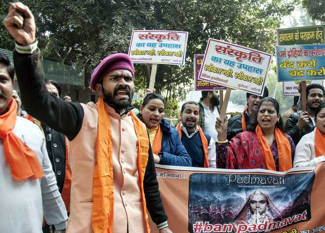 "Activists of different Hindu organisations display placards during a protest against the release of the film ""Padmaavat"" during a protest outside Delhi CM residence on Sunday. Credit: PTI"