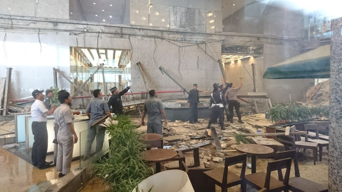 Workers and security examine the damage after a mezzanine floor collapsed at the Indonesia Stock Exchange building in Jakarta, Indonesia January 15, 2018 in this photo taken by Antara Foto. Antara Foto/Elo via REUTERS