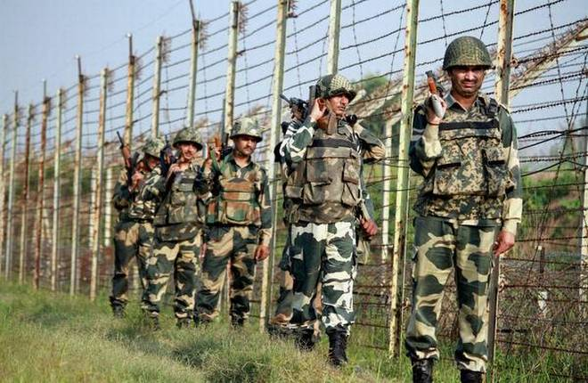 Border Security Force (BSF) personnel patrol along the International Border in RS Pura sector in Jammu. Credit: PTI