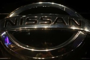 "FILE PHOTO: A company logo is seen on the newly-unveiled Nissan ""Terrano"" compact sport utility vehicle during a news conference in Mumbai, India August 20, 2013. Credit: Reuters/Danish Siddiqui/File Photo"