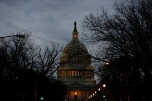The US Capitol is lit during the second day of a shutdown of the federal government in Washington, US, January 21, 2018. Credit: Reuters/Joshua Roberts