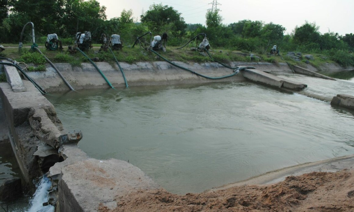 The diesel water pumps that farmers use to pull water to their fields in absence of sub-canals. Credit: Damayantee Dhar