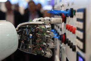 The hand of humanoid robot AILA (artificial intelligence lightweight android) operates a switchboard during a demonstration by the German research centre for artificial intelligence at the CeBit computer fair in Hanover March, 5, 2013. Credit: Reuters/Fabrizio Bensch