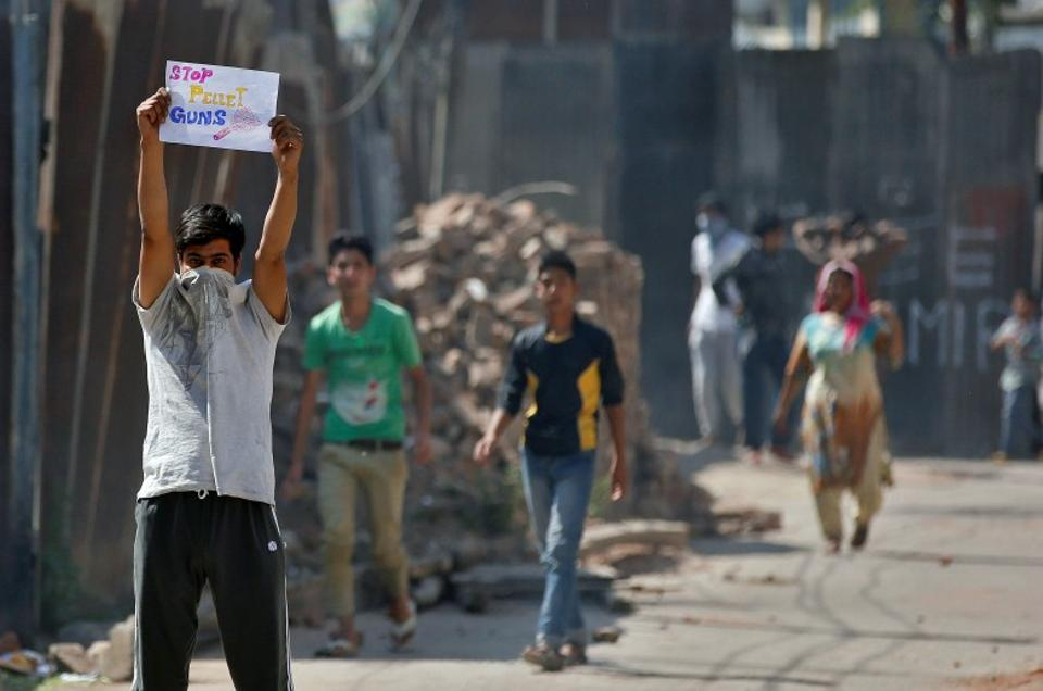 A demonstrator holds a placard during a protest in Srinagar, Kashmir. Credit: Reuters