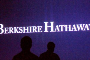 Berkshire Hathaway shareholders walk by a video screen at the company's annual meeting in Omaha, Nebraska, U.S., May 4, 2013. Credit: Reuters/Rick Wilking/Files
