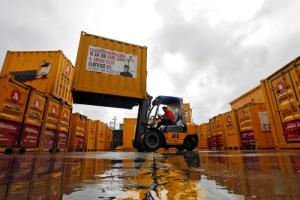 A forklift operator stacks containers at the godown of Agarwal Packers and Movers Ltd. on the outskirts of Mumbai, India June 29, 2017. Credit: Reuters/Shailesh Andrade