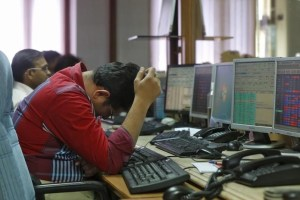 A broker reacts while trading at his computer terminal at a stock brokerage firm in Mumbai, India, February 26, 2016. Credit: Reuters/Shailesh Andrade/Files