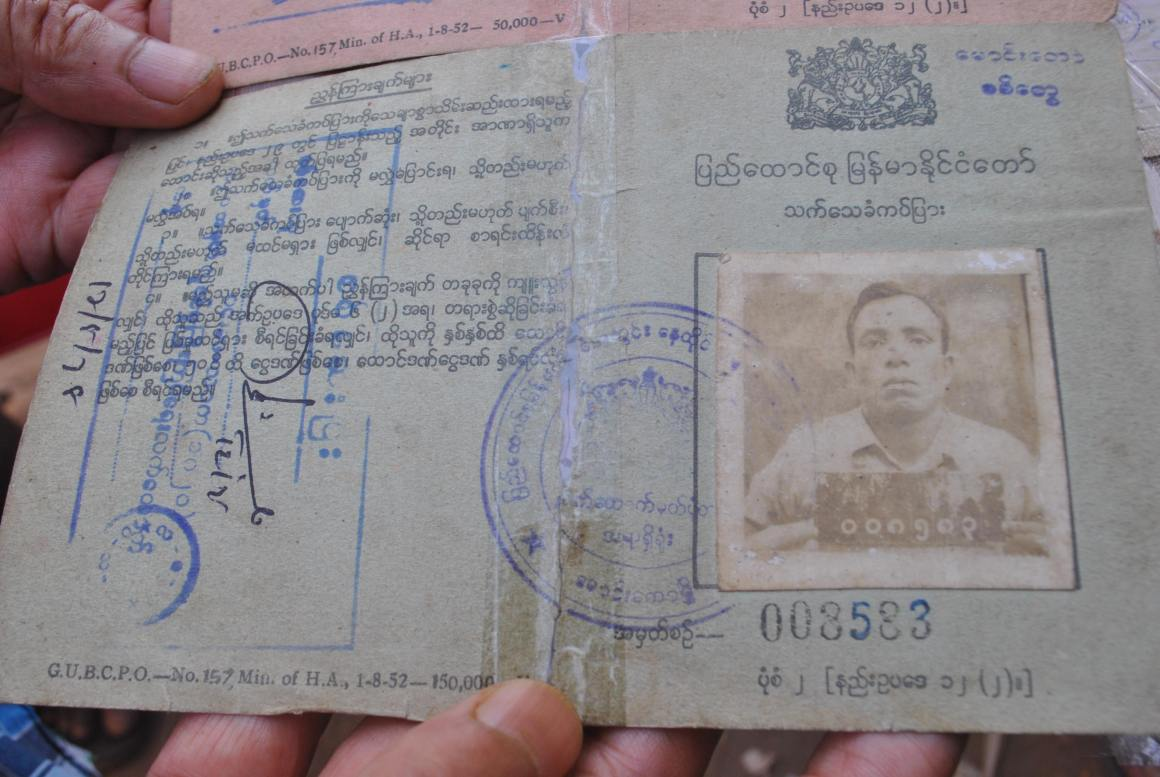 Syed Husain shows the national ID of his father, a former member of the Burmese army. The Myanmar government called this document false, and refused citizenship to the family. Credit: Rohini Mohan