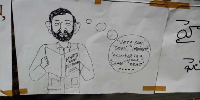 A poster at a protest depicting the MHRD's promises of a speedy resolution. Credit: IISc Students Council