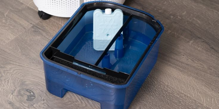The Frigidaire EC200WF's water tank, placed next to the swamp cooler so that the water and ice pack inside it are visible.