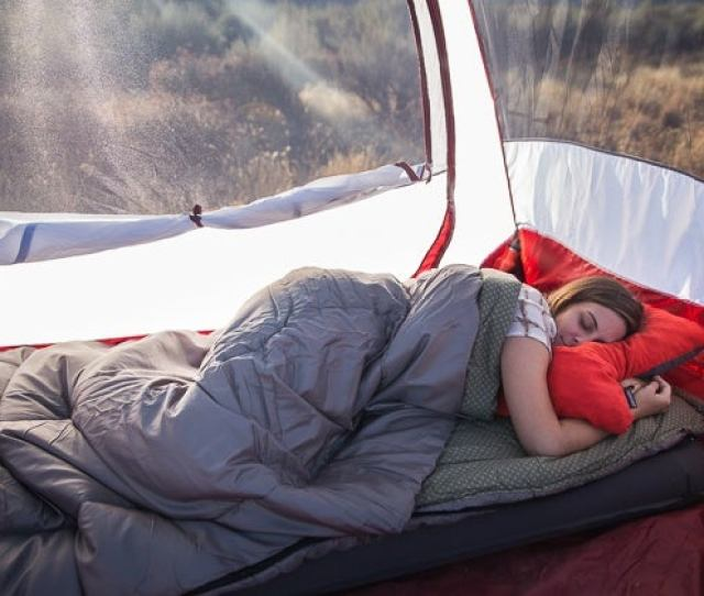 A Woman Sleeping In A Tent Using Our Pick For Best Car Camping Sleeping Bag