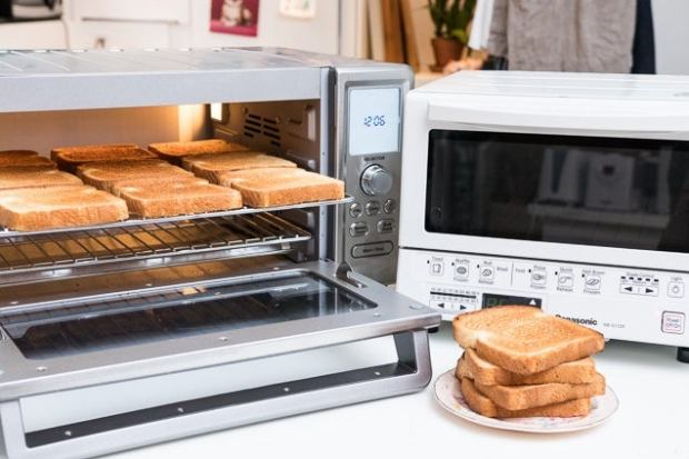 Nine slices of toast in a toaster oven next to another toaster oven that's off.