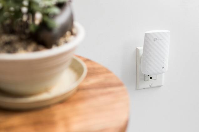 The TP-Link RE200, plugged into an outlet.