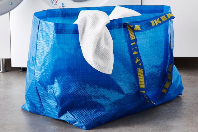 A large, blue reusable bag from IKEA.