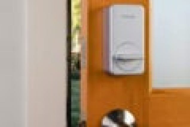 Close up of a wyze smart lock on door.