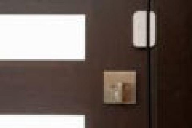 A stitch Wireless Smart Door Sensor on a door.