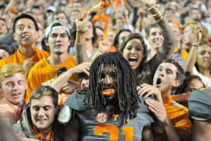 Oct 10, 2015; Knoxville, TN, USA; Tennessee Volunteers linebacker Jalen Reeves-Maybin (21) celebrates with fans after defeating the Georgia Bulldogs during the second half at Neyland Stadium. Tennessee won 38-31. Mandatory Credit: Jim Brown-USA TODAY Sports