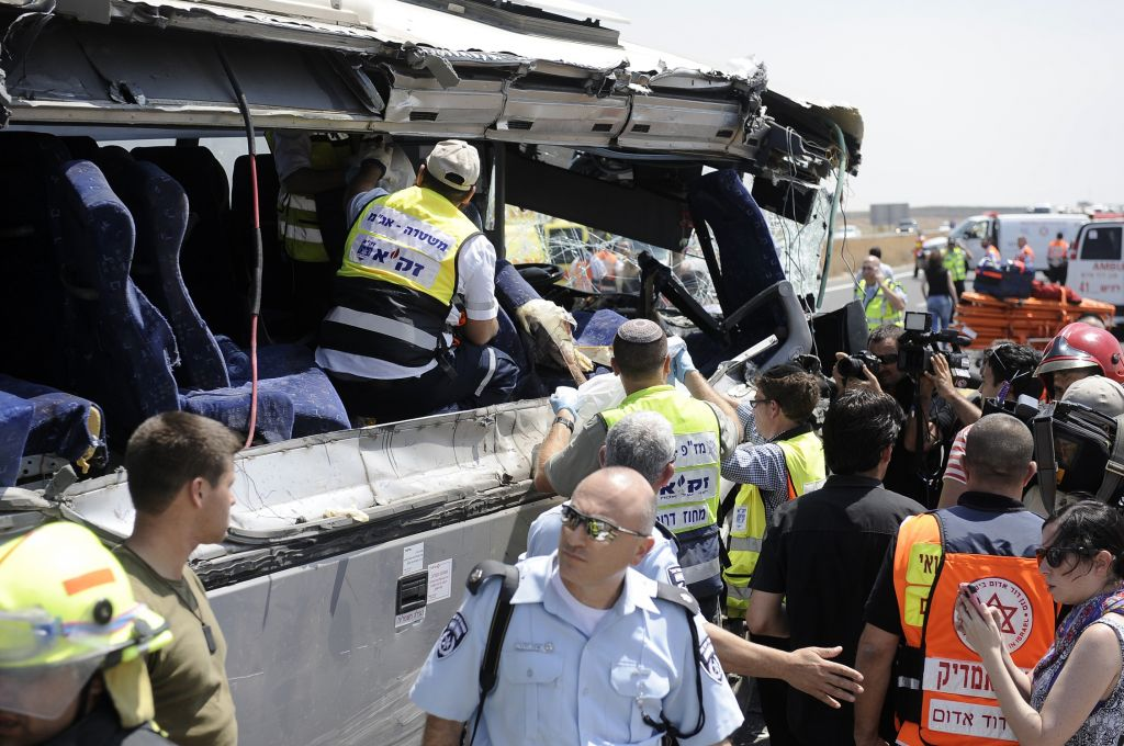 Rescue services at the scene of a lethal collision between a bus and a garbage truck on Route 6, Sunday, August 4, 2013 (photo credit: David Buimovitch/Flash90)