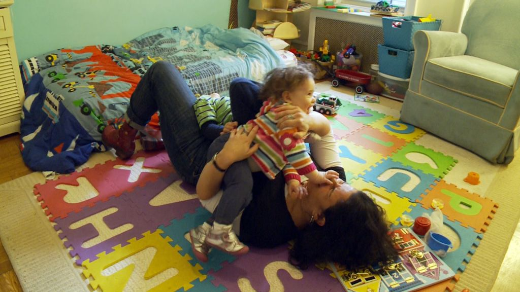 Rabbi Felicia Sol playing with her children. (Courtesy of Diva Communications, Inc.)