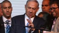 Le Premier ministre Netanyahu réagissant aux estimations de fin de soirée du 17 mars 2015 à Tel Aviv (Crédit : AFP/MENAHEM KAHANA)