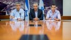 Finance Minister, Moshe Kahlon, center, is seen with Finance Ministry director Shai Ba'bed, right, and ministry budget head Amir Levi as they present the proposal for the state budget for 2015 in Jerusalem on August 2, 2015. (Yonatan Sindel/Flash90)