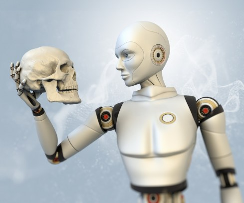 (Photo: Cyborg holding human skull image via Shutterstock)