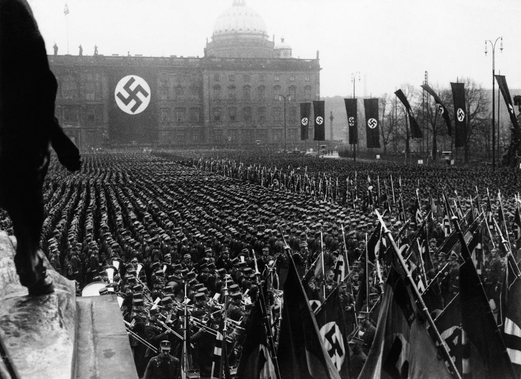 The Associated Press photographs the third anniversary of National Socialism's accession to power in 1933 widely celebrated throughout Germany on Feb. 11, 1936. At noon, Adolf Hitler assembled 25,000 of his oldest stormtroop comrades in the Lustgarten in Berlin. (AP Photo)