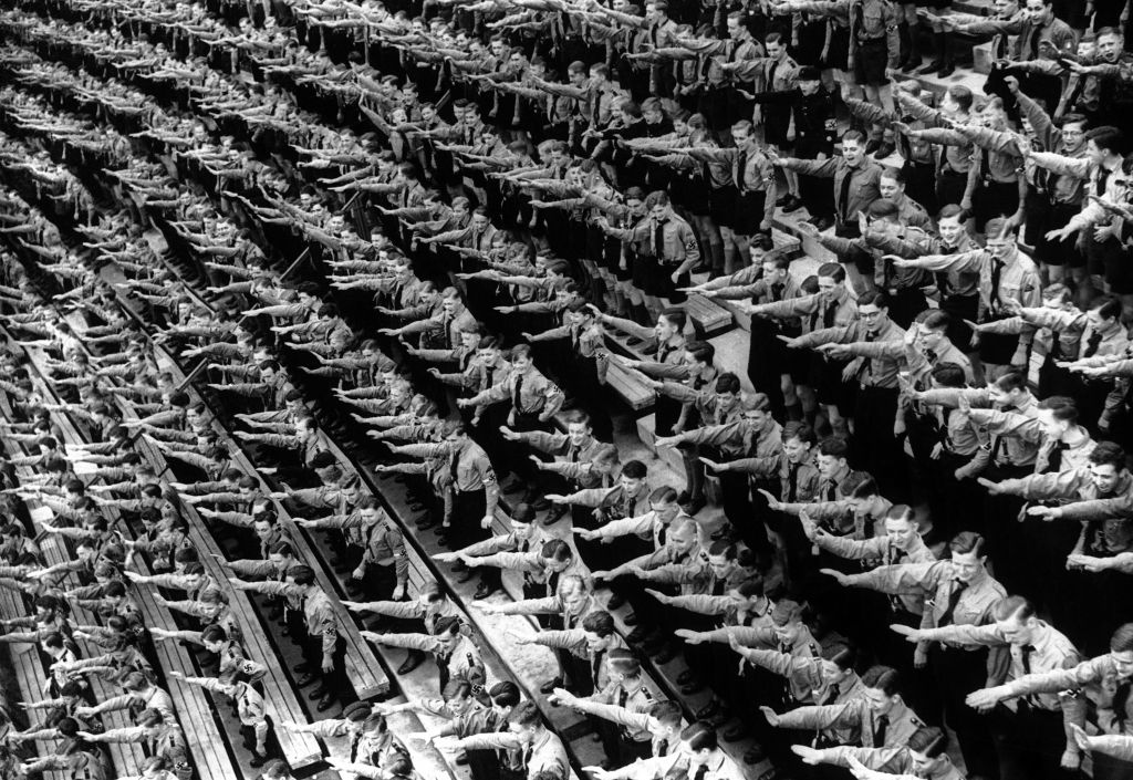 An Associated Press photograph shows some of over 132,000 members of the Hitler youth assembled at the Olympic Stadium in Berlin, Germany on May 1, 1939 (AP Photo)