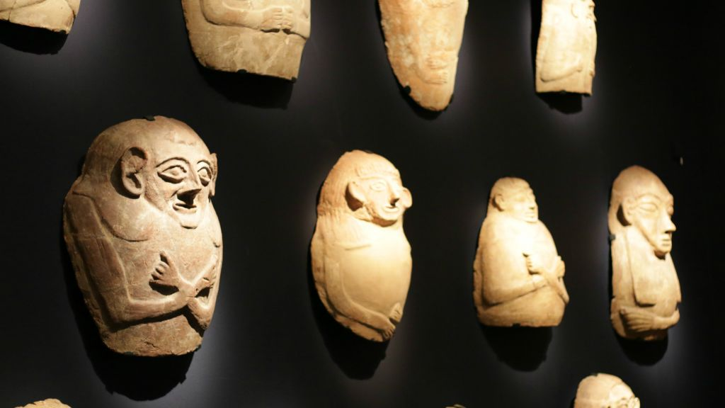 A series of Egyptian-style anthropoid coffins that served both Egyptians and Canaanites (Luke Tress/Times of Israel)
