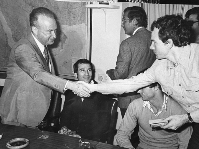 Israel's prime minister, Yitzhak Rabin, congratulates a player; that's Tal Brody beaming above the clasped hands.