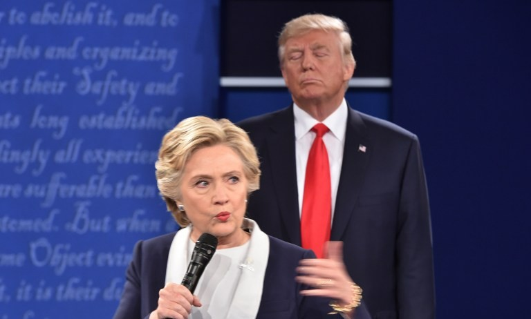 Republican presidential candidate Donald Trump listens to Democratic presidential candidate Hillary Clinton during the second presidential debate at Washington University in St. Louis, Missouri on October 9, 2016 (AFP/ Paul J. Richards)