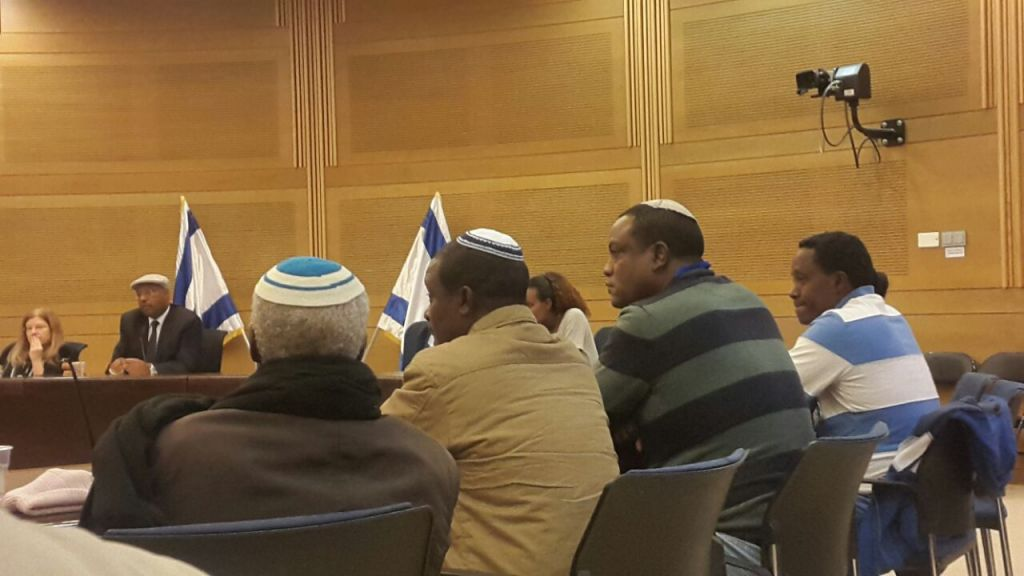 Ethiopian Israelis appeal to government to allow their relatives to immigrate in the Knesset on November 29, 2016. Yahallem Tadessa is pictured on the second right (Marissa Newman/Times of Israel)