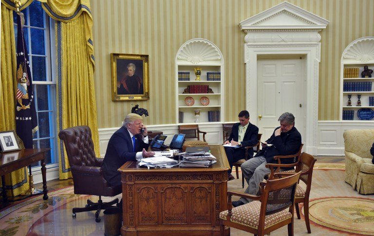 US President Donald Trump speaks on the phone with Australia's Prime Minister Malcolm Turnbull, alongside Chief Strategist Steve Bannon (R) and then National Security Advisor Michael Flynn, from the Oval Office of the White House on January 28, 2017, in Washington, DC. (AFP/Mandel Ngan)