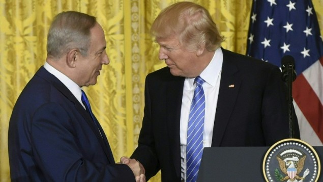 US President Donald Trump and Israeli Prime Minister Benjamin Netanyahu shake hands during a joint press conference at the White House in Washington, DC on February 15, 2017. (Saul Loeb/AFP)