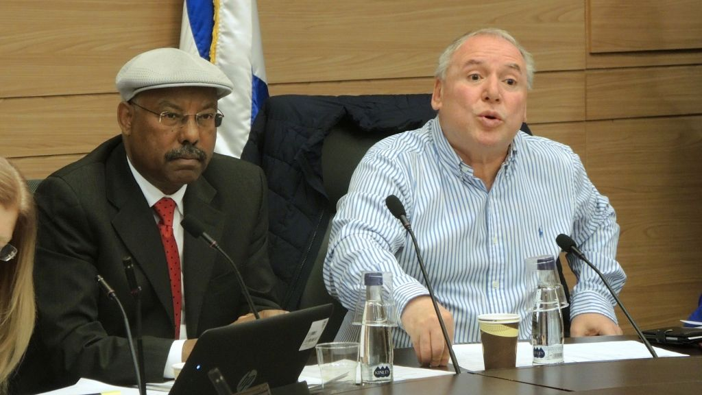 Likud MKs Avraham Neguise and David Amsalem grill representatives from the Ministry of the Interior over the Ethiopian aliyah freeze at a Knesset hearing on March 21, 2017. (Melanie Lidman/Times of Israel)
