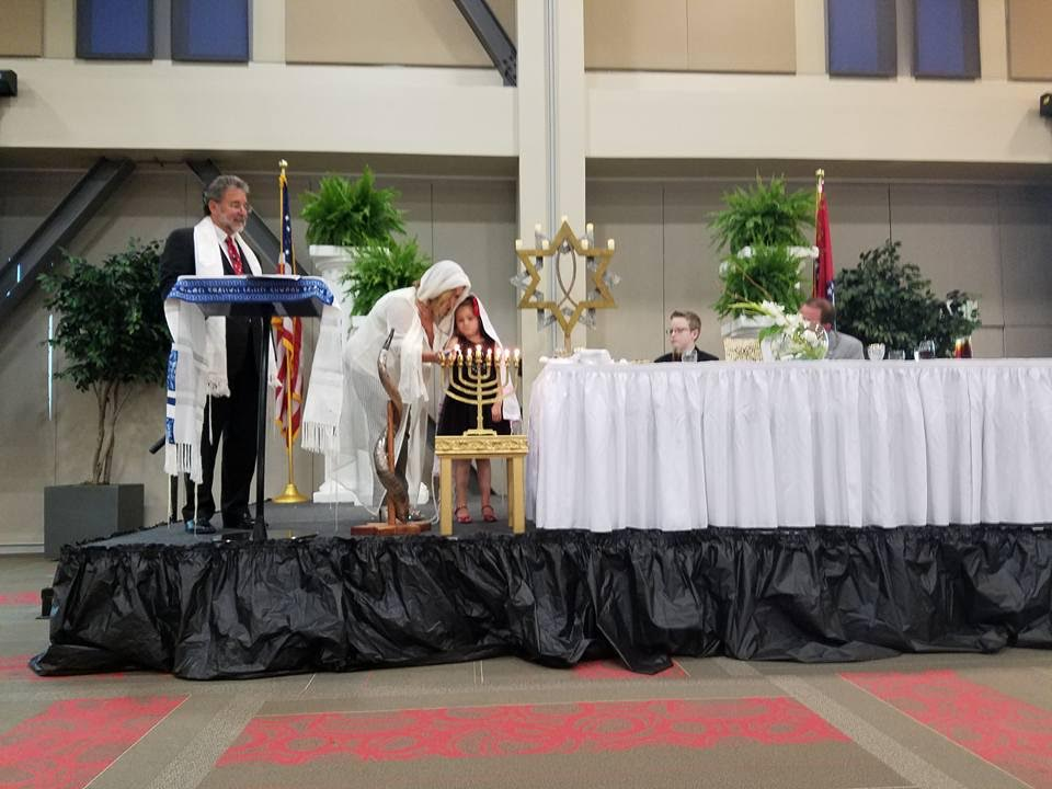 Lighting candles at the Cross Life Church seder in Alvarado, Arkansas. (Courtesy)