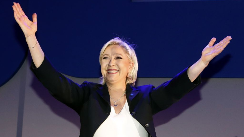 Far-right leader and candidate for the 2017 French presidential election, Marine Le Pen, cheers supporters on stage after exit poll results of the first round of the presidential election were announced, at her election day headquarters in Henin-Beaumont, northern France, Sunday, April 23, 2017. (AP Photo/Frank Augstein)